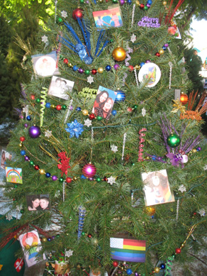 we took submission from our karmel scholarship and laminiated it to make them into ornaments to hang on the tree that way everyone could see the beautiful - Gay Pride Christmas Decorations