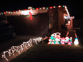 ... and a spot light for effect. Bright multi-colored lights edged the top of the house, all around. We were really in the Christmas spirit this year!!
